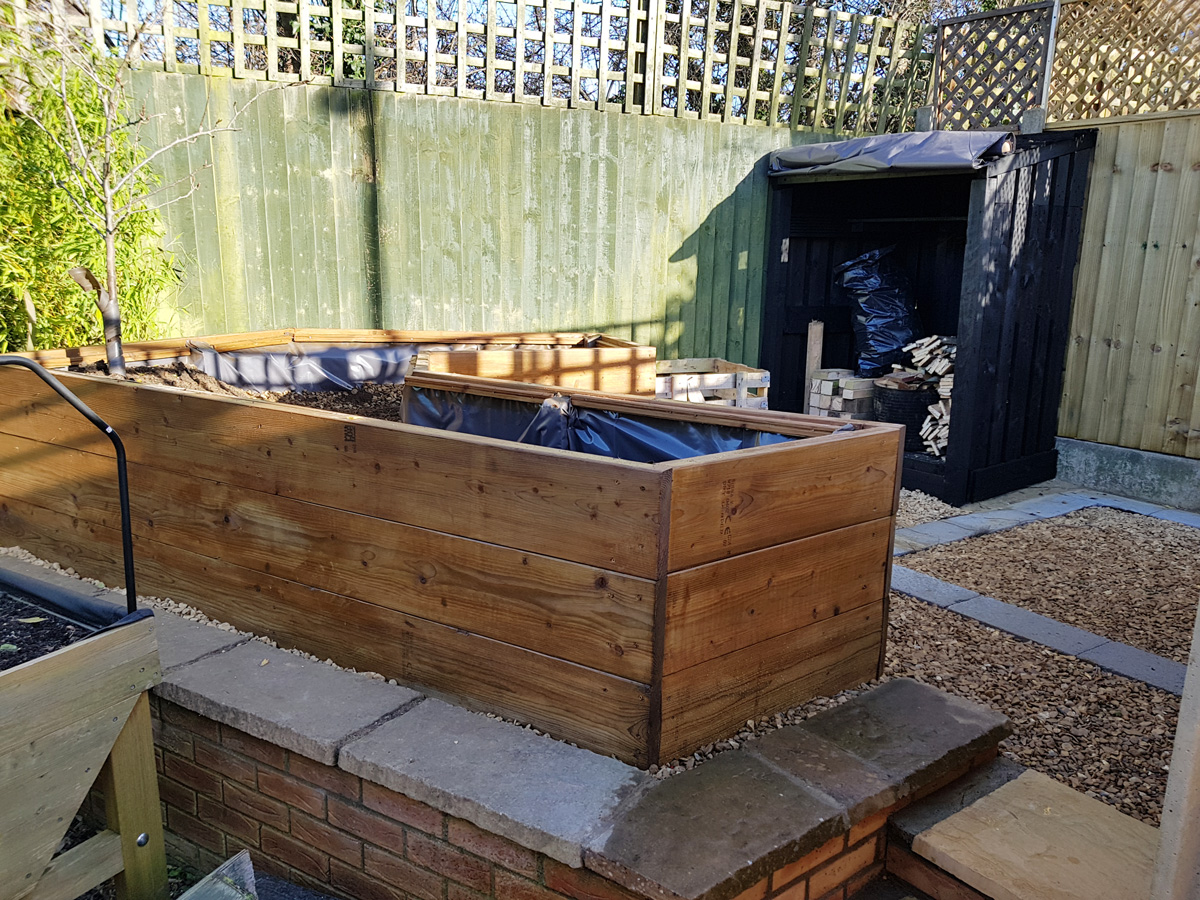 Vegetable planter and log store